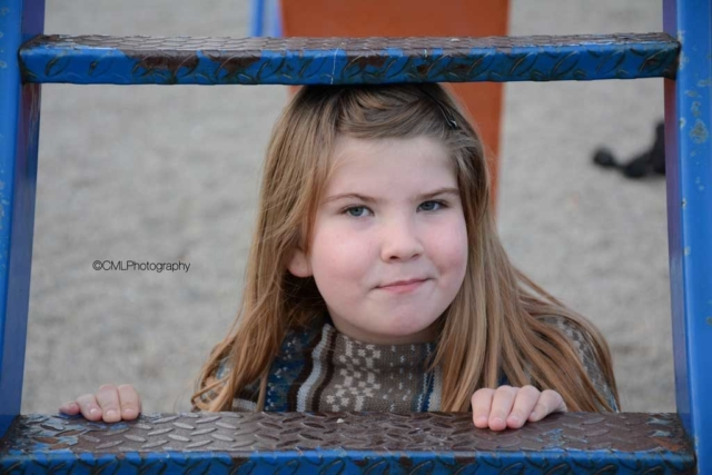 Zaley Ragaisis, 8, of Calgary, Alta, poses for a framing photography project. She is a sweet and energetic little girl.