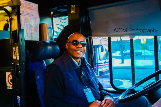 Michael Brown a Calgary Transit bus operator poses for an environmental portrait during his commute on the number one bus route.