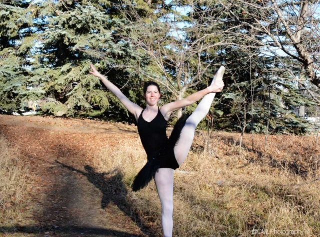 Katelyn Payette, 23, of Calgary, Alta, poses in an off leash dog park while doing Ballet. This photograph was originally used for a front lighting project.