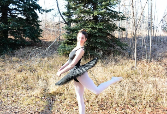 Katelyn Payette, 23, of Calgary, Alta, poses in an off leash dog park while doing Ballet. This photograph was originally used for a side lighting project.