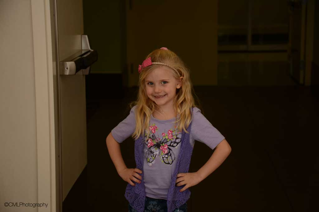 Charity Lovgren, 5, of Calgary, Alta, Poses for a flash photography project.